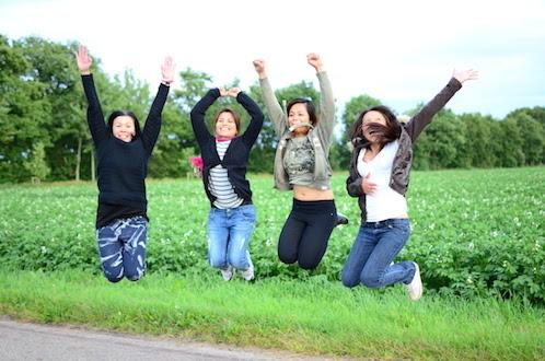thai ladies jumping in the air